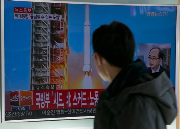People watch a television screen showing a breaking news on North Korea's long-range rocket launch at Seoul Station on February 7, 2016 in Seoul, South Korea. (Han Myung-Gu/Getty Images)