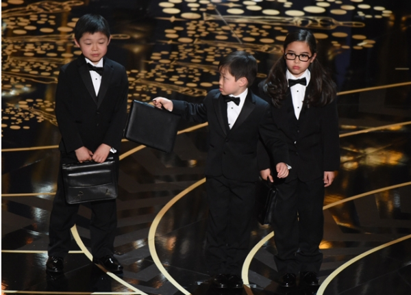 Children represent accountants from PricewaterhouseCoopers on stage at the 88th Oscars on February 28, 2016 in Hollywood, California. (Mark Ralston/AFP/Getty Images)