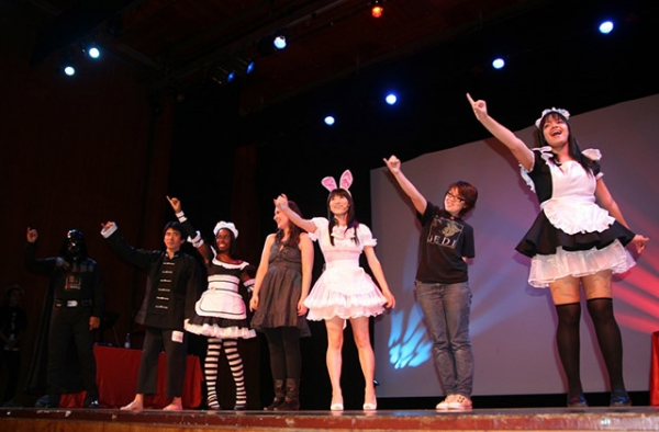 On October 15, 2010, audience members join Japanese singer Reni Mimura onstage for a performance during a cosplay competition at Asia Society in New York. (Elaine Merguerian/Asia Society)