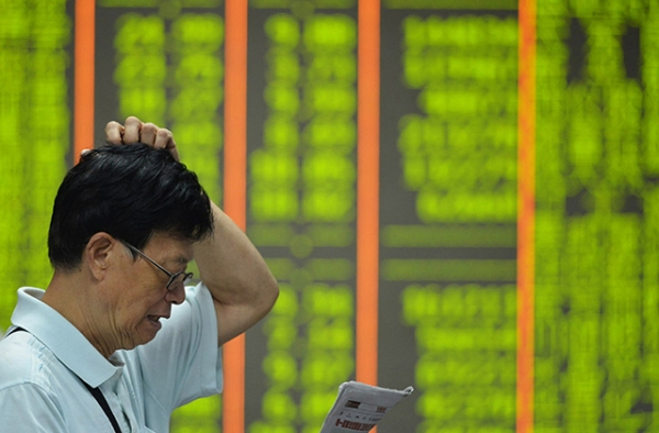 Veteran China-watchers explain what things they look for when monitoring China's economy. (STR/AFP/Getty Images)