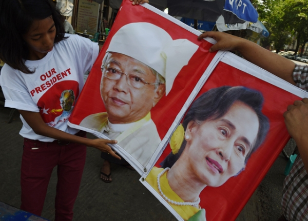 Supporters of the National League for Democracy (NLD) hold a banner displaying the portraits of new Myanmar President Htin Kyaw (L) and democracy icon Aung San Suu Kyi (R) in Yangon on April 10, 2016 ahead of the Thingyan new year festival. (ROMEO GACAD/AFP/Getty Images)