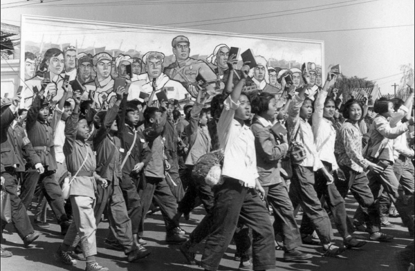 "In June, 1966, Chinese Red Guards — high school and university students — wave copies of Chairman Mao Zedong's ""Little Red Book"" as they parade in Beijing's streets. (Jean Vincent/AFP/Getty Images)"