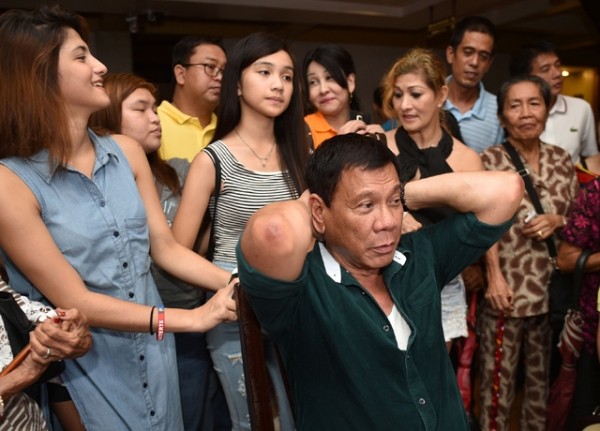 Philippine President-elect Rodrigo Duterte speaks during his first press conference since he claimed victory in the presidential election, at a restaurant in Davao City, on the southern island of Mindanao on May 15, 2016. (TED ALJIBE/AFP/Getty Images)