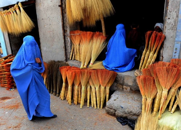 Afghan shoppers look for brooms at a roadside shop in Herat on April 9, 2014. (Aref Karimi/AFP/Getty Images)