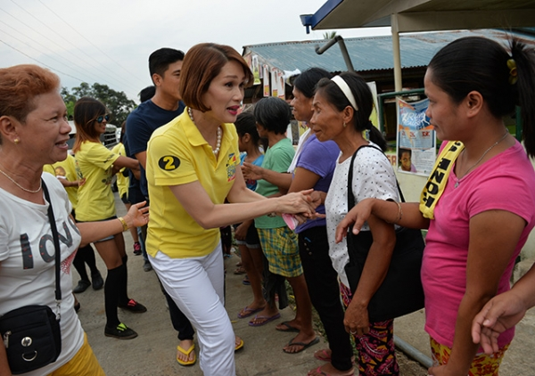 Geraldine Roman shakes hands with voters during a campaign trip to the town of Orani, Bataan province, north of Manila. (Ted Aljibe/AFP/Getty Images)