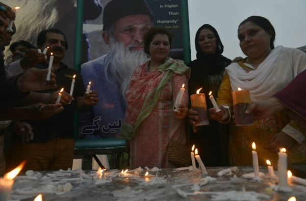 Pakistani supporters of Abdul Sattar Edhi hold candles during a candlelight vigil in his memory in Lahore on July 10, 2016. (Arif Ali/AFP/Getty Images)