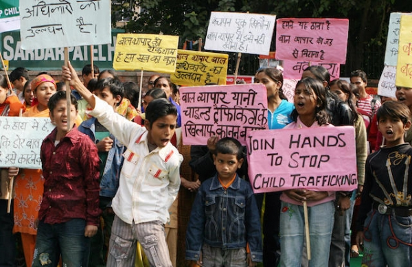 Indian children shout slogans during a protest in New Delhi on December 12, 2008 on the Global Day against Child Trafficking. (Raveendran/AFP/Getty Images)