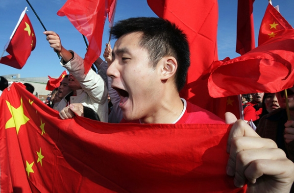 A Chinese supporter shouts at anti-Chinese protestors during the Olympic Torch relay at Parliament House on April 24, 2008 in Canberra, Australia. (Mark Nolan/Getty Images)