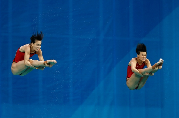 Tingmao Shi (R) and Minxia Wu (L) of China compete in the Women's Diving Synchronised 3m Springboard Final on Day 2 of the Rio 2016 Olympic Games at Maria Lenk Aquatics Centre on August 7, 2016 in Rio de Janeiro, Brazil. (Clive Rose/Getty Images)