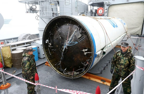 The wreckage of a North Korean rocket is seen at the Second Fleet Command's naval base on December 14, 2012 in Pyeongtaek, South Korea. The debris is the first stage of a long range rocket that launched on December 12, 2012. (Yeong-Wook/DongA Daily/Getty)