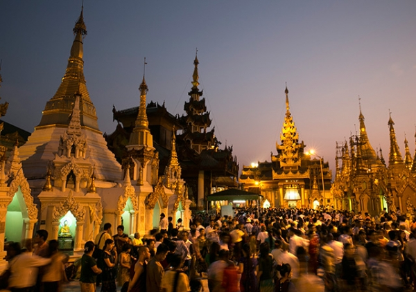 Thousands of worshippers come to the Shwedagon pagoda to celebrate Thingyan, a New Years Water festival, April 17, 2014 in Yangon, Myanmar. Thingyan is similar to other new year festivities seen in Southeast Asian countries such as Laos, Cambodia and Songkran in Thailand. (Paula Bronstein/Getty Images)