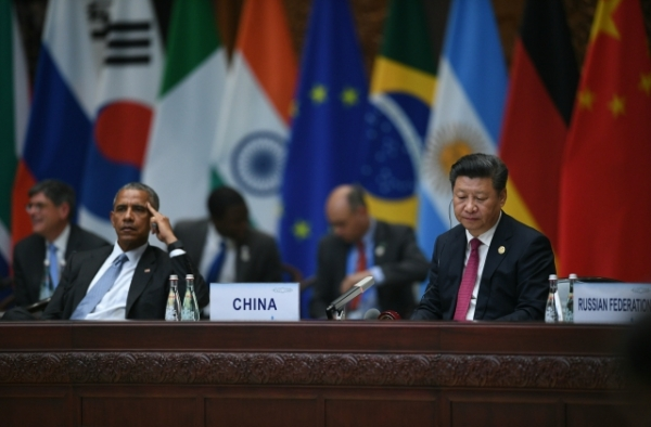 U.S. President Barack Obama (L) looks on with China's President Xi Jinping (R) during a meeting at the G20 Summit in Hangzhou on September 4, 2016. (Johannes Eisele/AFP/Getty Images)