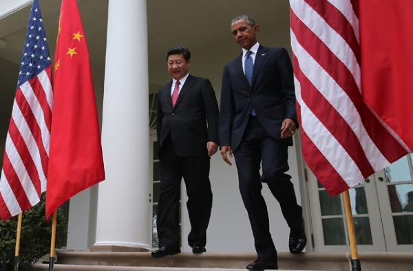 U.S. President Barack Obama (R) and Chinese President Xi Jinping arrive to a joint news conference in the Rose Garden at The White House on September 25, 2015 in Washington, D.C. (Mark Wilson/Getty Images)