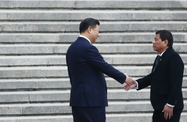 President of the Philippines Rodrigo Duterte and Chinese President Xi Jinping shake hands as they attend a welcoming ceremony at the Great Hall of the People on October 20, 2016 in Beijing, China. (Thomas Peter/Pool-Getty Images)