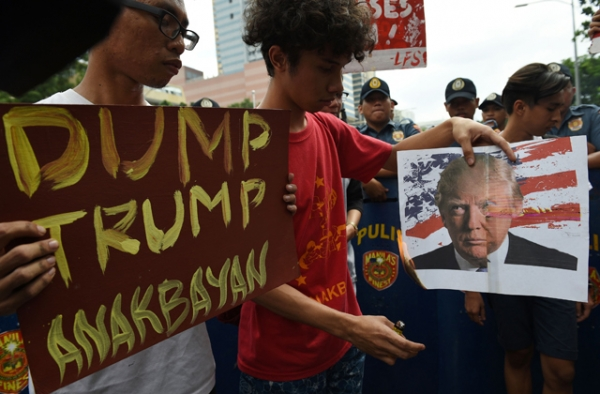 Filipino students burn an mock US flag and photo of US President-elect Donald Trump during a rally in front of the US embassy in Manila on November 10, 2016. (Ted Aljibe/AFP/Getty Images)