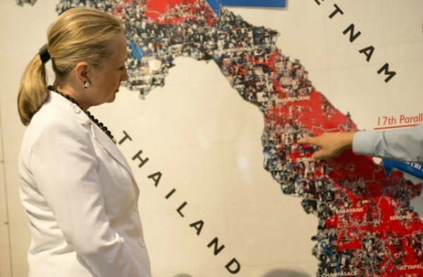 U.S. Secretary of State Hillary Clinton views an exhibit on Vietnam War bombing in Vientiane, Laos. (Brendan Smialowski/AFP/Getty Images)