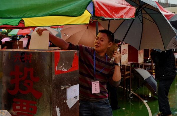 A local resident votes during elections in the village of Wukan on March 31, 2014. (Mark Ralston/AFP/Getty Images)
