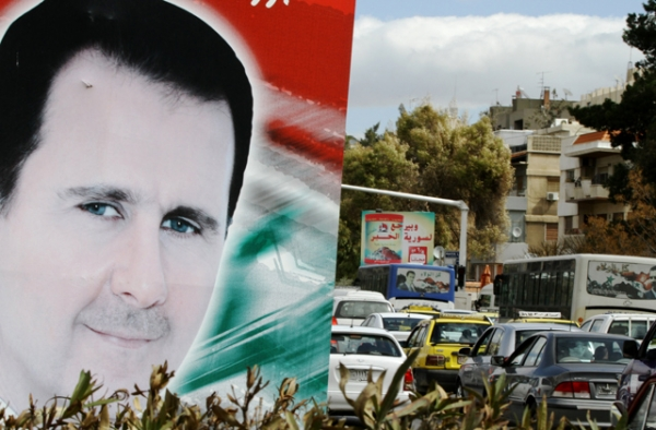 A photo taken on March 4, 2015 shows a banner bearing a portrait of Syrian President Bashar al-Assad in a street in the city of Damascus. (Louai Beshara/AFP/Getty Images)
