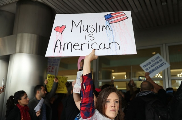 Demonstrators at Miami International Airport protest an executive order that President Donald Trump signed clamping down on refugee admissions and temporarily restricting travelers from seven predominantly Muslim countries on January 29, 2017. (Joe Raedle/Getty)