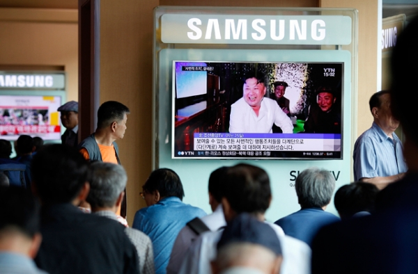 South Koreans watch TV news reporting the North Korea's nuclear test at the Seoul Railway Station. (Woohae Cho/Getty Images)