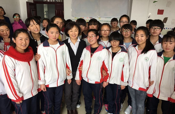 Tien Ching poses with girls in the EGRC program. (Tien Ching)