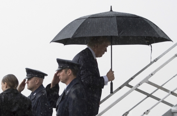 U.S. President Donald Trump departs for his two-day summit meeting with Xi Jinping on Air Force One. (Jim Watson/AFP/Getty Images)