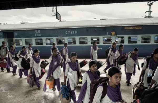Girls arriving in Bangalore in June from rural villages for their new factory jobs. (Andrea Bruce/New York Times)