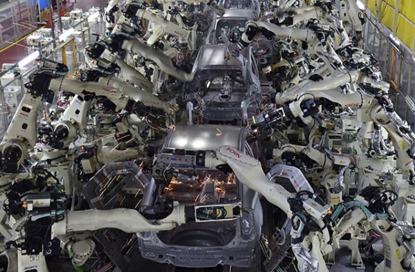 Welding machine robots assemble automobile bodies at Toyota Motor's Tsutsumi plant. (Kazuhiro Nogi/AFP/Getty Images)