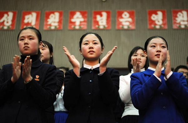 A group of North Korean teenagers clap as they watch a performance in Pyongyang. (Mark Ralston/AFP/Getty)
