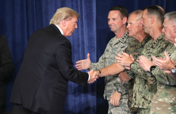 U.S. President Donald Trump greets military leaders before his speech on Afghanistan at the Fort Myer military base on August 21, 2017 in Arlington, Virginia. (Mark Wilson/Getty Images)