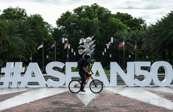 A man rides his bicycle in front of the ASEAN logo near the venue for the Association of Southeast Asia Nations (ASEAN) Regional Forum (ARF) meeting in Manila on August 4, 2017. (Mohd Rasfan/AFP/Getty Images)