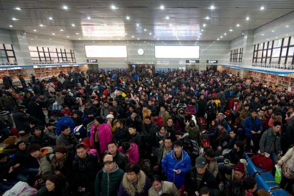 Lunar New Year travellers wait for their train at the West Railway Station in Beijing on January 31, 2013. (Ed Jones/AFP/Getty Images)