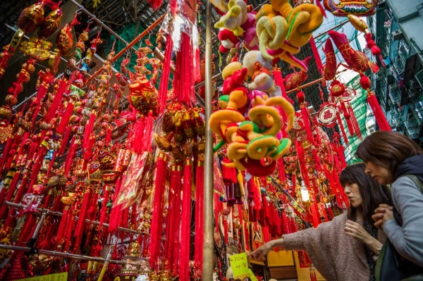 Two women look at a display of Lunar New Year items for sale at a street market in Hong Kong on January 31, 2013. (Philippe Lopez/AFP/Getty Images)