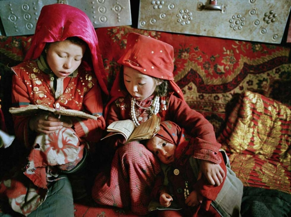 Three young Kyrgyz girls learn to read the Koran on a winter morning at Tshar Tash camp, near the source of the Amu Darya river, in the remote Pamir plateau of northeastern Afghanistan. (Matthieu Paley)