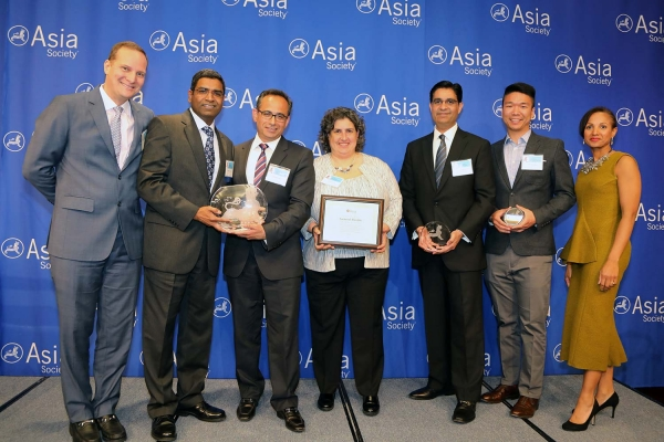Mahendra Nair (L2) on behalf of General Electric receives the award for Best Employer for Marketing & Support to APA Community. (Ellen Wallop/Asia Society)