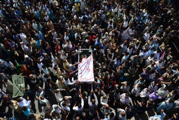 Pakistani Shiite Muslims carry a coffin during the funeral procession of bomb blast victims in Karachi on March 4, 2013. (Rizwan Tabassum/AFP/Getty Images)