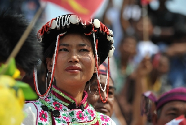 A Kachin tribe woman listens to Aung San Suu Kyi in the town of Moe Kaung on February 23, 2012. (Soe Than Win/Getty Images)
