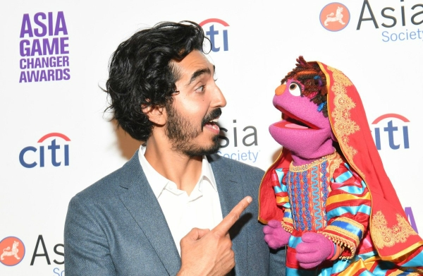 Dev Patel greets Zari the muppet at the Asia Game Changer Awards