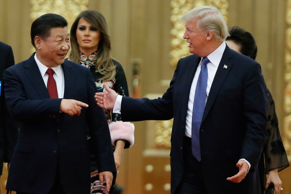 Xi Jinping talks with Donald Trump in China