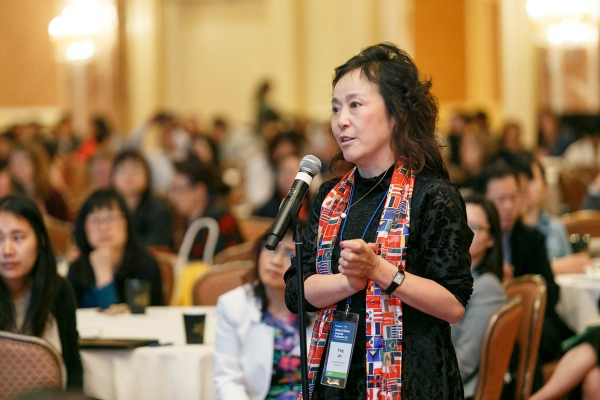 Ying Jin, the 2018 National Language Teacher of the Year named by ACTFL, asks a question during one of the plenary sessions at the 2018 National Chinese Language Conference