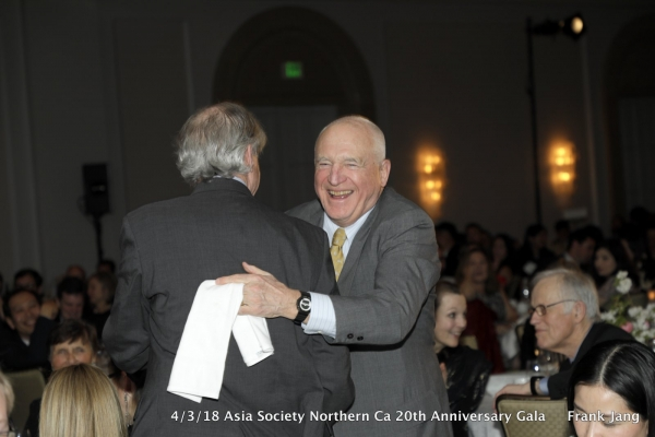 Asia Society Chief Financial Officer and Senior Vice President Don Nagle (left) and ASNC Advisory Board Co-Chair, Jack Wadsworth (right) share an embrace (Frank Jang/Asia Society)