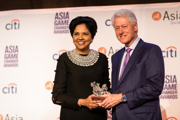 Indra Nooyi and Bill Clinton at the Asia Game Changers awards ceremony in New York, October 9, 2018
