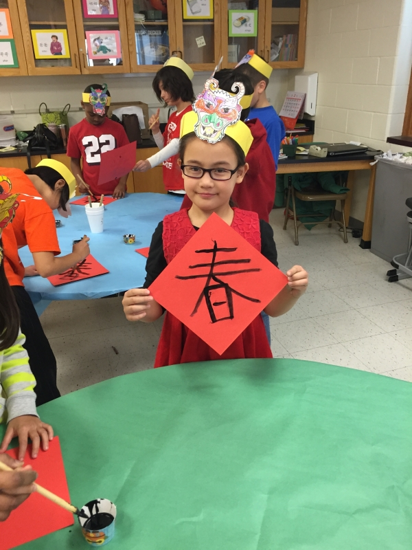Students in the Chinese culture class work on a project.