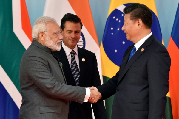Narendra Modi greets Xi Jinping on the sidelines of a BRICS summit in 2017.