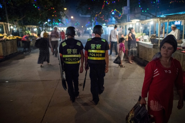 Han Chinese police officers patrol in Xinjiang