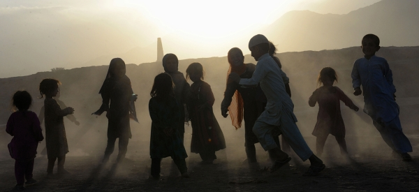 Afghan children play on the outskirts of Jalalabad. (Noorullah Shirzada/AFP/Getty Images)