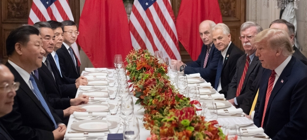 U.S. President Donald Trump and China's President Xi Jinping, along with members of their delegations, hold a dinner meeting.