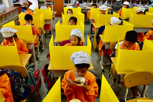 Schoolchildren in Taiwan eat lunch