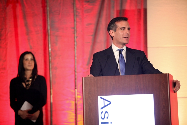 From right, Eric Garcetti, Los Angeles City Council, 13th District speaks by host journalist Lisa Ling during the Asia Society Southern California 2013 Annual Gala held at the Millennium Biltmore Hotel on Tuesday, February 19, 2013 in Los Angeles, Calif. (Photo by Ryan Miller/Capture Imaging)