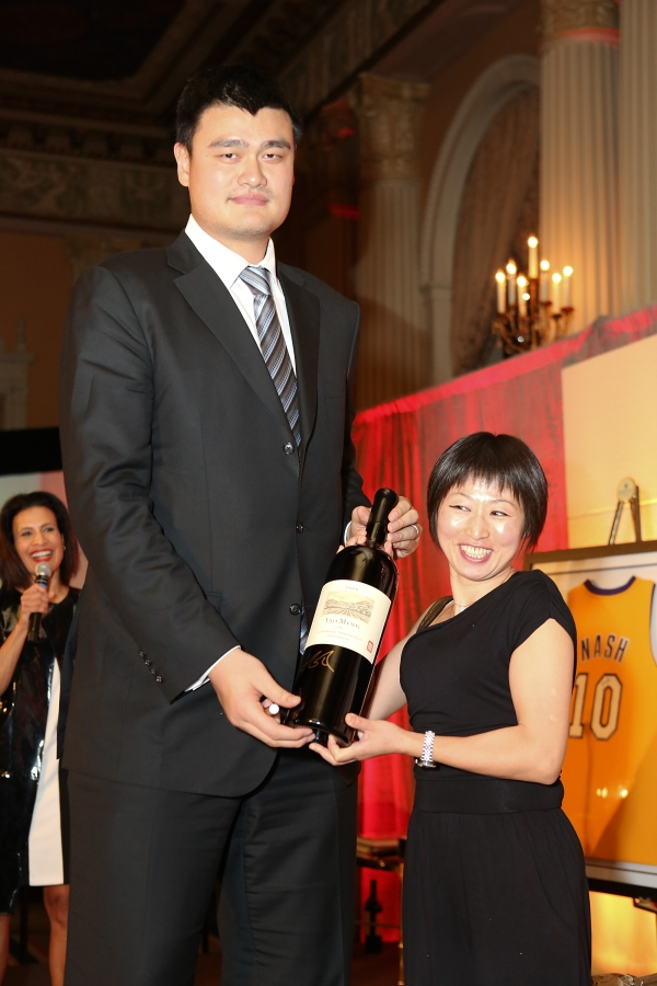 "From left, Yao Ming, honored as ""Visionary of the Year"" and Shipping Xu, General Counsel DeWind, the winning bider for an autographed bottle of Yao Family Wine pose during the Asia Society Southern California 2013 Annual Gala held at the Millennium Biltmore Hotel on Tuesday, February 19, 2013 in Los Angeles, Calif. (Photo by Ryan Miller/Capture Imaging)"